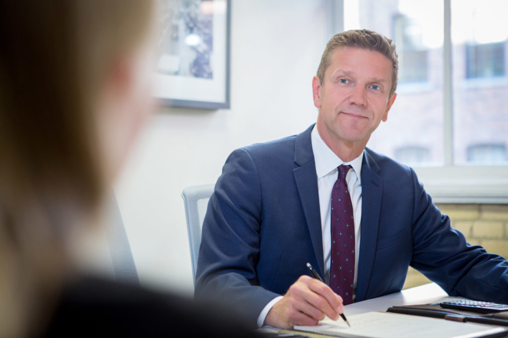 Kurt Rosentreter in a meeting with a client